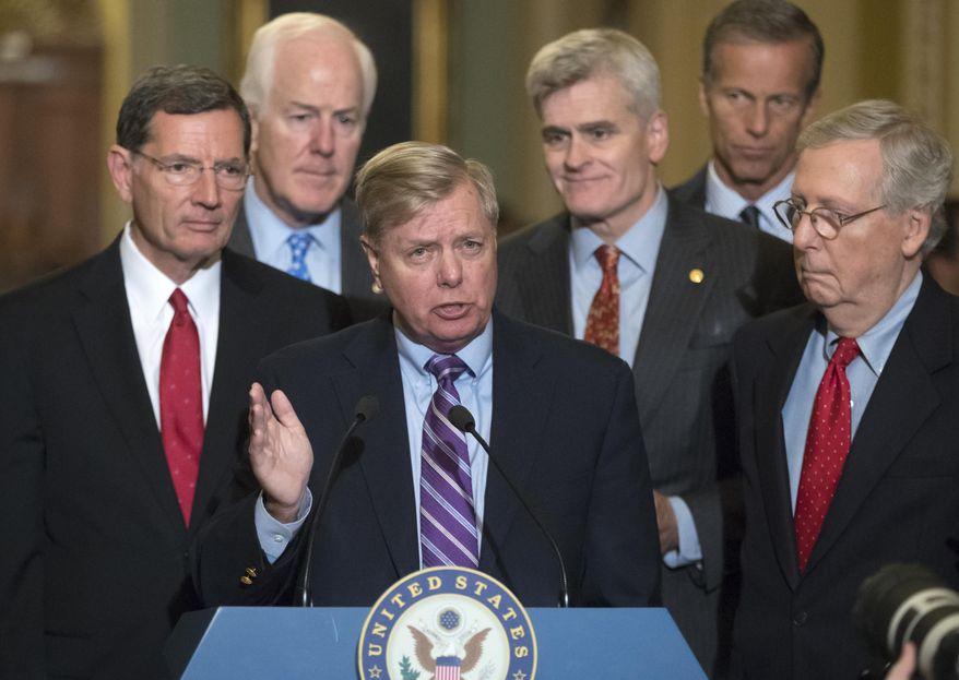 Sen. Lindsey Graham, R-S.C., joined by, from left, Sen. John Barrasso, R-Wyo., Majority Whip John Cornyn, R-Texas, Sen. Bill Cassidy, R-La., Sen. John Thune, R-S.D., and Senate Majority Leader Mitch McConnell, R-Ky., speaks to reporters as he pushes a last-ditch effort to uproot former President Barack Obama's health care law, at the Capitol in Washington, Tuesday, Sept. 19, 2017. (AP Photo/J. Scott Applewhite)