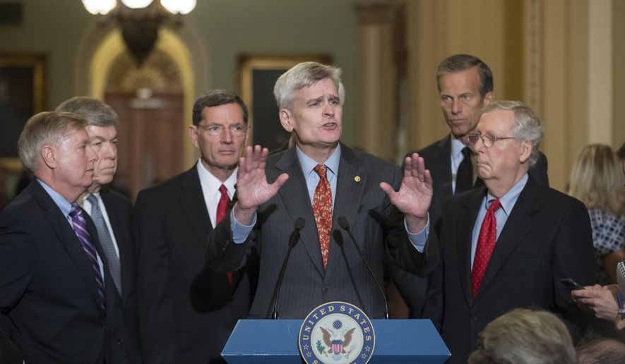Sen. Bill Cassidy, R-La., center, joined by, from left, Sen. Lindsey Graham, R-S.C., Sen. Roy Blunt, R-Mo., Sen. John Barrasso, R-Wyo., Sen. John Thune, R-S.D., and Senate Majority Leader Mitch McConnell, R-Ky., speaks to reporters as he pushes a last-ditch effort to uproot former President Barack Obama's health care law, at the Capitol in Washington, Tuesday, Sept. 19, 2017. (AP Photo/J. Scott Applewhite)