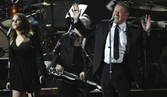 "CORRECTS DATE OF ANNOUNCEMENT TO TUESDAY, SEPT. 19 INSTEAD OF WEDNESDAY, SEPT. 20 - FILE - In this Friday, Feb. 10, 2017, file photo, Don Henley performs ""Free Fallin"" at the MusiCares Person of the Year tribute at the Los Angeles Convention Center. Henley, Lyle Lovett and Clint Black are the latest musicians planning a concert to raise money for victims of Harvey. The trio on Tuesday, Sept. 19 announced a Nov. 28 show at Bass Hall in Fort Worth, Texas. (Photo by Chris Pizzello/Invision/AP, File)"