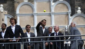 Spain's tennis player Rafael Nadal, center, throws a ball to fans during a welcome ceremony of the Laver Cup at the Old Town square in Prague, Czech Republic, Wednesday, Sept. 20, 2017. The competition will pit a team of the best six European players against the top six from the rest of the world. The inaugural edition is scheduled for Sept. 22-24 at the O2 Arena in Prague. The Laver Cup is named after the Australian tennis legend Rod Laver. (AP Photo/Petr David Josek)