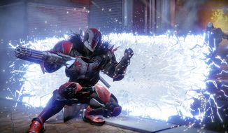 A Titan warrior deploys a barricade to temporarily duck enemy attacks in the first-person shooting video game Destiny 2. (Courtesy of Activision)