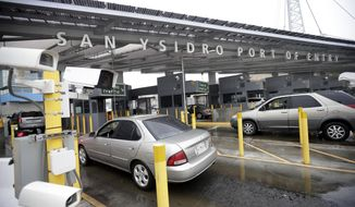 FILE - In this Dec. 3, 2014, file photo cars wait to enter the United States from Tijuana, Mexico through the San Ysidro port of entry in San Diego. Federal authorities say two people were hit by a car and killed as they sprinted from a van that sped across the border from Tijuana, Mexico, into San Diego County. Border Patrol agent Tekae Michael says the incident happened around 2 a.m. Sunday, Sept. 17, 2017, at the San Ysidro Port of Entry. (AP Photo/Gregory Bull, File)