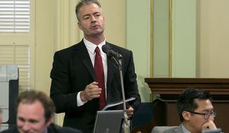 In this Friday, Sept. 15, 2017, photo, Assemblyman Travis Allen, R-Huntington Beach, speaks at the Assembly, in Sacramento, Calif. Sacramento Superior Court Judge Timothy Frawley, tentatively ruled in favor of Allen's arguments against Attorney General Xavier Becerra's summary of an initiative to repeal a gas tax increase, saying it was misleading and should be rewritten. (AP Photo/Rich Pedroncelli)