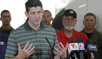 Speaker of the House Paul Ryan of Wis. talks to reporters during a news briefing after assessing damages in the Florida Keys caused by Hurricane Irma, at the Coast Guard Air Station Miami, Wednesday, Sept. 20, 2017, in Opa-locka, Fla. (AP Photo/Alan Diaz)