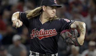 Cleveland Indians starting pitcher Mike Clevinger throws against the Los Angeles Angels during the first inning of a baseball game in Anaheim, Calif., Tuesday, Sept. 19, 2017. (AP Photo/Chris Carlson)
