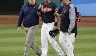 In this Tuesday, Aug. 8, 2017 file photo, Cleveland Indians' Michael Brantley, center, walks off the field with a trainer, left, and manager Terry Francona in the fifth inning of a baseball game, in Cleveland. Indians All-Star outfielder Michael Brantley is running out of time to get healthy before the postseason. Brantley remains sidelined with a sprained tendon in his right ankle. On Tuesday, Sept. 19, 2017, Brantley visited a foot and ankle specialist in Vail, Colorado. (AP Photo/Tony Dejak, File)