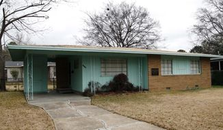 FILE - This Jan. 29, 2008 file photo, shows the house of slain civil rights leader Medgar Evers in Jackson, Miss. Mississippi civil rights sites, including the home of Evers, should be considered for national monument designation, the U.S. interior secretary says in a memo to President Donald Trump. In Feb. 2017, the National Park Service designated the Evers home a national historic landmark. (AP Photo/Rogelio V. Solis, File)