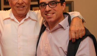 "This undated photo released and made available by Babak Namazi, who is the brother of Siamak Namazi and son of Baquer Namazi, shows Baquer Namazi, left, and his son Siamak in an unidentified location. The U.N.'s Working Group on Arbitrary Detention said Monday, Sept. 18, 2017, that Baquer and Siamak Namazi, two Iranian-Americans serving 10-year prison sentences on spying charges in Iran should be immediately freed and paid restitution, calling their ""arbitrary"" detention part of an ""emerging pattern"" by Tehran of targeting dual nationals. (Babak Namazi via AP)"