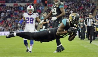 "FILE - In this Oct. 25, 2015, file photo, Jacksonville Jaguars wide receiver Allen Hurns (88) makes a diving catch for a touchdown during an NFL football game against the Buffalo Bills at Wembley Stadium in London. Hurns got the nickname ""Mr. London"" last year, after his 42-yard touchdown reception beat Indianapolis across the pond. He also made a diving, 31-yard TD catch to stun Buffalo at Wembley Stadium in 2015. Hurns goes for a threepeat abroad Sunday against Baltimore. (AP Photo/Tim Ireland, File)"