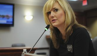 FILE - In this an. 28, 2016 file photo, South Dakota Republican state Rep. Lynne DiSanto testifies in a state House committee at the Capitol in Pierre, S.D. DiSanto has apologized for a Facebook post where she shared a meme Sept. 7, 2017, depicting protesters being hit by a vehicle. It was posted less than a month after a driver rammed through counter-protesters at a white nationalist rally in Charlottesville, Va.,  killing a woman. (AP Photo/James Nord, File)