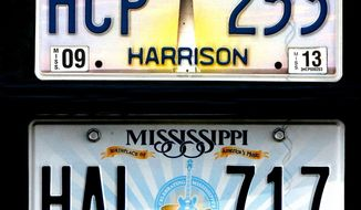 "This undated photo shows the Biloxi Lighthouse plate, top, and the plate that replaced it which pictures blues legend BB King's guitar ""Lucille"" and the phrase ""Birthplace of America's Music"" in Mississippi. The license plate with the guitar will remain unchanged because the state legislature didn't allocate funds to replace them. (Tim Isbell/The Sun Herald via AP)"