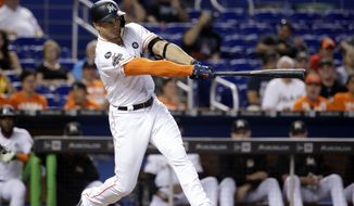 Miami Marlins' Giancarlo Stanton hits an RBI single to score Miguel Rojas in the fourth inning of a baseball game against the New York Mets, Wednesday, Sept. 20, 2017, in Miami. (AP Photo/Lynne Sladky)