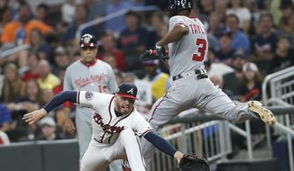 Washington Nationals' Michael Taylor (3) beats out a ground ball for a single as Atlanta Braves first baseman Freddie Freeman (5) reaches for the ball in the fifth inning of a baseball game Wednesday, Sept. 20, 2017, in Atlanta. (AP Photo/John Bazemore) **File**