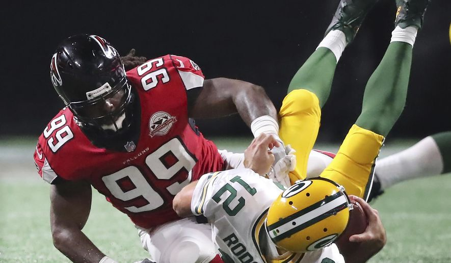 In this Sunday, Sept. 17, 2017 file photo, Atlanta Falcons defensive end Adrian Clayborn sacks Green Bay Packers quarterback Aaron Rodgers for a loss during the third quarter of an NFL football game in Atlanta. Green Bay Packers quarterback Aaron Rodgers doesn't hold back on the field, even when teammates around him limp off to the sideline. Coach Mike McCarthy spoke broadly about the injuries before practice on Wednesday, Sept. 20, 2017.  (Curtis Compton/Atlanta Journal-Constitution via AP, File)