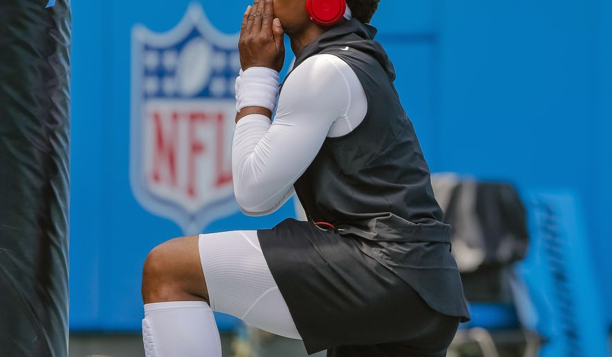 FILE - In this Sept. 17, 2017, file photo, Carolina Panthers' Cam Newton finishes a prayer before an NFL football game between against the Buffalo Bills in Charlotte, N.C. The Panthers defense has been dominant in the first two weeks of the season, but Cam Newton and the offense know they're going to have to start completing drives and scoring touchdowns instead of field goals. (AP Photo/Bob Leverone, File)