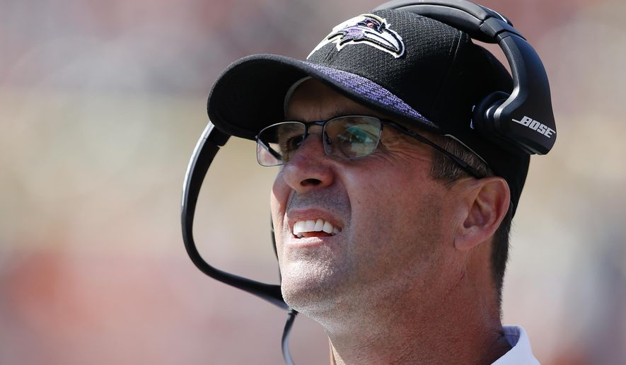 FILE - In this Sunday, Sept. 10, 2017, file photo, Baltimore Ravens head coach John Harbaugh works the sideline in the second half of an NFL football game against the Cincinnati Bengals in Cincinnati. The Ravens head to London this week to take on Jacksonville Jaguars on Sunday at Wembley Stadium. (AP Photo/Gary Landers, File)