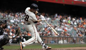 San Francisco Giants' Buster Posey singles during the first inning of a baseball game against the Colorado Rockies, Wednesday, Sept. 20, 2017, in San Francisco. (AP Photo/Marcio Jose Sanchez)