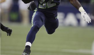 FILE - In this Aug. 18, 2017, file photo, Seattle Seahawks running back Chris Carson (32) hurdles Minnesota Vikings cornerback Jabari Price during the first half of an NFL football preseason game, in Seattle. Carson was a draft-day afterthought, taken in the seventh round by the Seahawks as another body to throw in their running back room. Two games into the regular season Carson has established himself as the Seahawks best running option so far.(AP Photo/Scott Eklund, File)