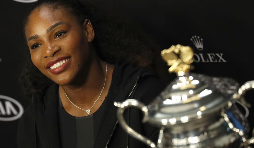 FILE - In this Jan. 28, 2017, file photo, Serena Williams answers questions at a press conference after defeating her sister Venus to win the women's singles final at the Australian Open tennis championships in Melbourne, Australia. Williams praised her mother Oracene Price for being a role model in an open letter posted to Reddit on Sept. 19, 2017. (AP Photo/Kin Cheung, File)