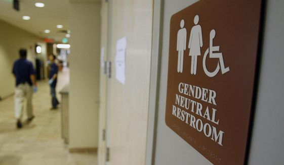 In this Aug. 23, 2007, file photo, a sign marks the entrance to a gender-neutral restroom at the University of Vermont in Burlington, Vt. (AP Photo/Toby Talbot, File)