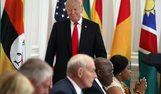 President Donald Trump walks to his seat after speaking during a luncheon with African leaders at the Palace Hotel during the United Nations General Assembly, Wednesday, Sept. 20, 2017, in New York. (AP Photo/Evan Vucci)