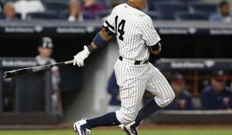 New York Yankees second baseman Starlin Castro (14) follows through on a run-scoring single during the sixth inning of a baseball game against the Minnesota Twins in New York, Tuesday, Sept. 19, 2017. (AP Photo/Kathy Willens)
