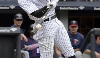 New York Yankees' Aaron Judge hits a two-run home run during the third inning of a baseball game against the Minnesota Twins Wednesday, Sept. 20, 2017, at Yankee Stadium in New York. (AP Photo/Bill Kostroun)