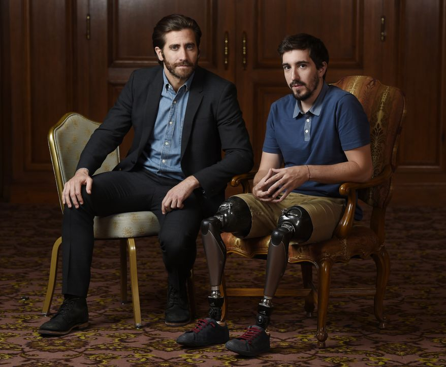 """In this Sept. 10, 2017 photo, Jake Gyllenhaal, left, poses for portrait with Boston Marathon bombing survivor Jeff Bauman during the Toronto International Film Festival in Toronto. Gyllenhaal portrays Bauman in the film """"Stronger."""" (Photo by Chris Pizzello/Invision/AP)"""