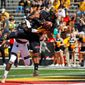 Maryland receiver D.J. Moore leads the Big Ten with an average of 115 yards receiving per game while the Terrapins score 57 points per game. (Associated Press)