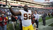 Washington Redskins defensive tackle Albert Haynesworth (92) throws souvenirs to the fans as he leaves the field after the Redskins beat the Tennessee Titans 19-16 in overtime during an NFL football game on Sunday, Nov. 21, 2010, in Nashville, Tenn. (AP Photo/Joe Howell)