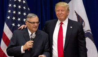 In this Jan. 26, 2016, file photo, then-Republican presidential candidate Donald Trump is joined by Joe Arpaio, the sheriff of metro Phoenix, at a campaign event in Marshalltown, Iowa. (AP Photo/Mary Altaffer, File)