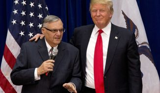 FILE - In this Jan. 26, 2016 file photo, Republican presidential candidate Donald Trump is joined by Joe Arpaio, the sheriff of metro Phoenix, at a campaign event in Marshalltown, Iowa. Prosecutors in former Sheriff Joe Arpaio's now-pardoned criminal case face a deadline Thursday, Sept. 21, 2017, for explaining why they now believe the case should be dismissed and all rulings should be thrown out. Judge Susan Bolton set the deadline after she found that prosecutors hadn't offered any legal authority to back up their argument. (AP Photo/Mary Altaffer, File)