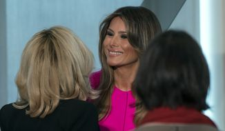 U.S. First lady Melania Trump greets First lady Brigitte Macron, left, wife of President Emmanuel Macron of France, after she addressed a luncheon at the U.S. Mission to the United Nations in New York Wednesday, Sept. 20, 2017.  (AP Photo/Craig Ruttle)
