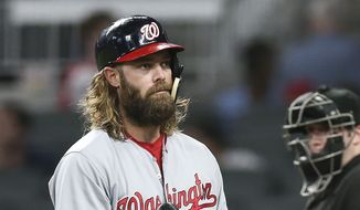 Washington Nationals' Jayson Werth (28) flips his bat as he walks to the dugout after striking out in the ninth inning of a baseball game against the Atlanta Braves Thursday, Sept. 21, 2017, in Atlanta. Atlanta won 3-2. (AP Photo/John Bazemore)