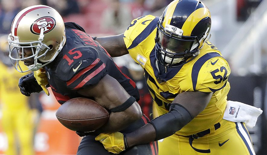 San Francisco 49ers wide receiver Pierre Garcon (15) is tackled by Los Angeles Rams inside linebacker Alec Ogletree (52) during the first half of an NFL football game in Santa Clara, Calif., Thursday, Sept. 21, 2017. (AP Photo/Marcio Jose Sanchez)