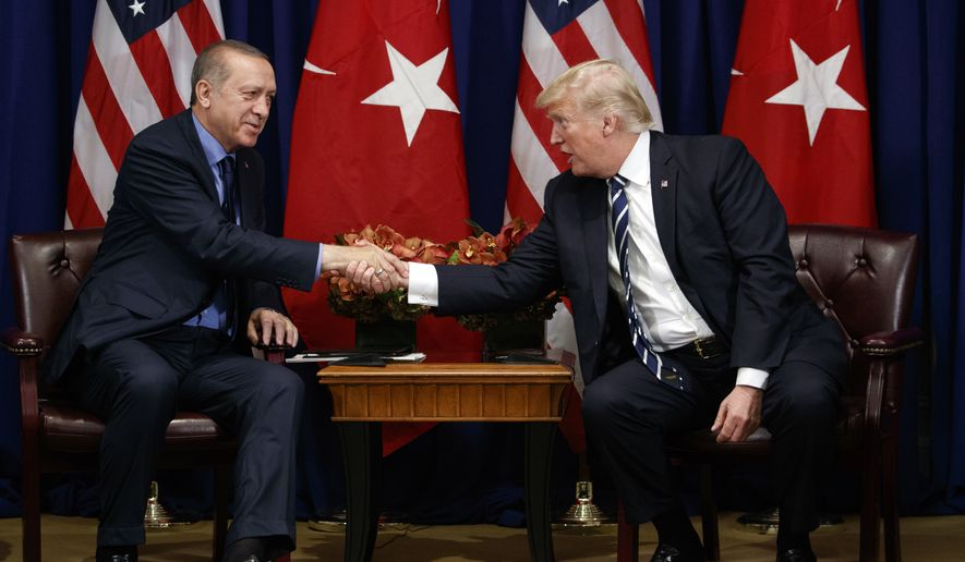 President Donald Trump shakes hands with Turkish President Recep Tayyip Erdogan during a meeting at the Palace Hotel during the United Nations General Assembly in New York on Sept. 21, 2017. (Associated Press) **FILE**
