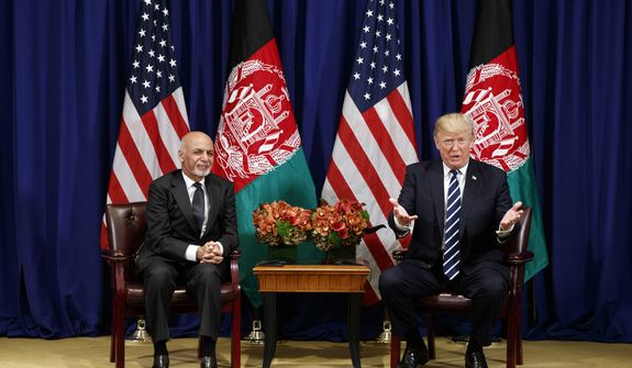 President Donald Trump meets with Afghan President Ashraf Ghani at the Palace Hotel during the United Nations General Assembly, Thursday, Sept. 21, 2017, in New York. (AP Photo/Evan Vucci)