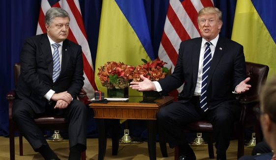 President Donald Trump meets with Ukraine's President Petro Poroshenko at the Palace Hotel during the United Nations General Assembly, Thursday, Sept. 21, 2017, in New York. (AP Photo/Evan Vucci/File)
