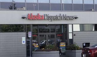 FILE - In this Sept. 11, 2017, file photo, the current offices of the Alaska Dispatch news are shown in a strip mall in Anchorage, Alaska. The new owners of Alaska's largest newspaper have laid off reporters, editors and other employees just days after a bankruptcy judge approved the sale the Alaska Dispatch News.  Co-Publisher Ryan Binkley wouldn't disclose how many of the 212 employees were laid off, but described it in a story published Thursday, Sept. 21 as a significant change in the size of the newspaper. (AP Photo/Mark Thiessen, File)