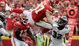 Kansas City Chiefs tight end Travis Kelce (87) leaps over Philadelphia Eagles cornerback Rasul Douglas (32) for a touchdown during the second half of an NFL football game in Kansas City, Mo., Sunday, Sept. 17, 2017. (AP Photo/Charlie Riedel)