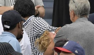 In this Sept. 20, 2017 photo, a young girl is carried out of the seating area after being hit by a line drive during the fifth inning of a baseball game between the New York Yankees and Minnesota Twins, at Yankee Stadium in New York. About a third of the 30 major league teams, the Yankees not among them, have extended the netting to protect fans from balls entering the bleachers to at least the end of the dugout. (AP Photo/Bill Kostroun, File)