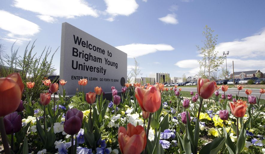This April 19, 2016, file photo, shows a welcome sign to Brigham Young University in Provo, Utah. Mormon-church owned Brigham Young University in Utah announced Thursday, Sept. 21, 2017 that it is reversing its six-decade ban on selling caffeinated soft drinks on its campus. (AP Photo/Rick Bowmer, File)