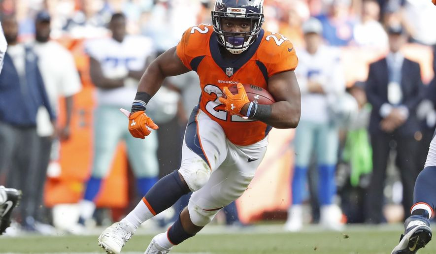 FILE - In this Sunday, Sept. 17, 2017, file photo, Denver Broncos running back C.J. Anderson runs against the Dallas Cowboys during the second half of an NFL football game in Denver. Anderson is off to a great start in his comeback from a knee injury that ended his 2016 season at the midway point. (AP Photo/Jack Dempsey, File)