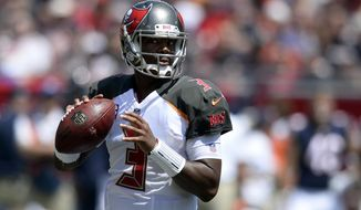 FILE - In this Sunday, Sept. 17, 2017, file photo, Tampa Bay Buccaneers quarterback Jameis Winston (3) looks to pass  during the first half of an NFL football game against the Chicago Bears in Tampa, Fla. When Xavier Rhodes was in his final season at Florida State, the scout team quarterback was a cocksure redshirt named Jameis Winston. Five years later, Rhodes and the Minnesota Vikings are well aware of what Winston can do to beat them on the field, as they prepare to host the Buccaneers. (AP Photo/Jason Behnken, File)
