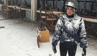 In this image provided by Northstar California, Jessie Hall, an employee at the Northstar California Resort looks out at the first snow of the season Thursday, Sept. 21, 2017, in Truckee, Calif. Snow is falling in the Sierra Nevada on the last day of summer, dusting hills and ski resorts with fresh snow and stoking excitement for an early skiing season. Forecasters say a rare cool weather system moving south from Oregon is bringing mountain rain and snow showers to the Sierra Thursday. Warmer and drier weather is expected by the weekend. (Northstar California via AP)