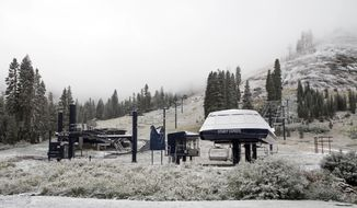 In this image provided by Ski Bowl, the first snowfall of the season is seen atop the Disney Express Lift at Ski Bowl Thursday, Sept. 21, 2017, in Norden, Calif. Snow is falling in the Sierra Nevada on the last day of summer, dusting hills and ski resorts with fresh snow and stoking excitement for an early skiing season. Forecasters say a rare cool weather system moving south from Oregon is bringing mountain rain and snow showers to the Sierra Thursday. Warmer and drier weather is expected by the weekend. (Ski Bowl via AP)