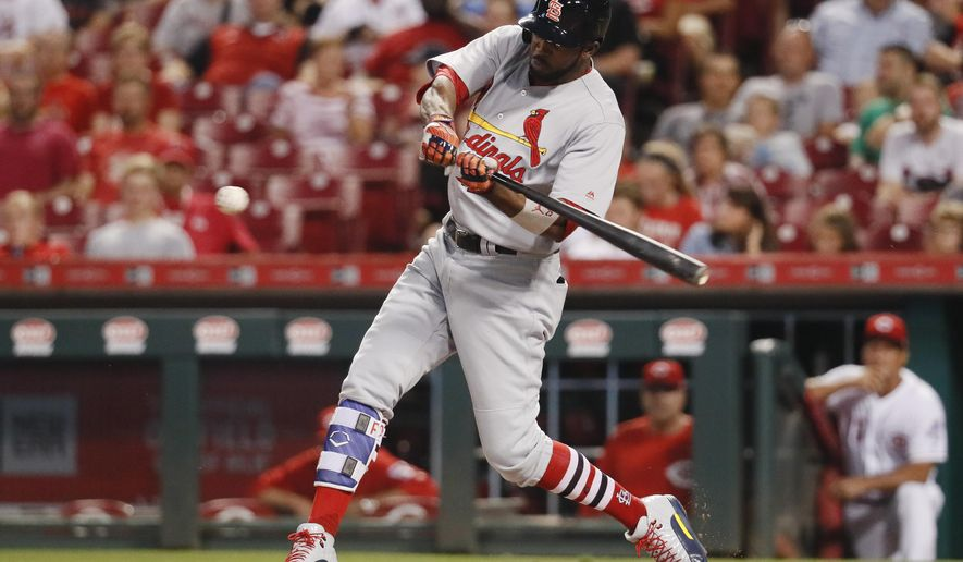 St. Louis Cardinals' Dexter Fowler swings for a two-run double off Cincinnati Reds starting pitcher Homer Bailey during the third inning of a baseball game, Thursday, Sept. 21, 2017, in Cincinnati. (AP Photo/John Minchillo)