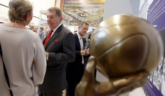 In this Wednesday, Sept. 20, 2017 photo, Jerry Colangelo greets guests at the grand opening of the Jerry Colangelo Museum at Grand Canyon University in Phoenix. Colangelo has been an NBA and MLB owner, director of USA Basketball and the Naismith Hall of Fame. He's also made significant contributions to Grand Canyon University and the school is celebrating his career with an on-campus museum. (AP Photo/Matt York)