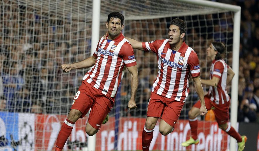 CAPTION CORRECTS THE DATE - FILE - In this Wednesday, April 30, 2014 file photo, Atletico's Diego Costa, left celebrates with teammate Koke after he scored a penalty during their Champions League semifinal second leg soccer match against Chelsea at Stamford Bridge Stadium in London. Atletico Madrid and Chelsea on Thursday, Sept. 21 say they have reached an agreement for the transfer of striker Diego Costa to the Spanish club. Chelsea says it gave Costa permission to travel to Madrid to undergo a medical and finalize the contract details with his former club. (AP Photo/Kirsty Wigglesworth, file)