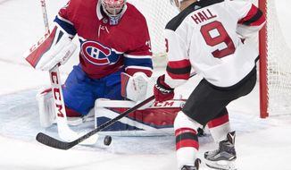Montreal Canadiens goalie Carey Price (31) stops New Jersey Devils left wing Taylor Hall (9) during the third period of a preseason NHL hockey game, Thursday, Sept. 21, 2017 in Montreal. (Ryan Remiorz/The Canadian Press via AP)